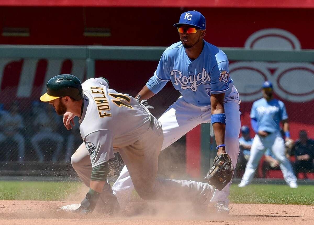 Oakland Athletics' Dustin Fowler steals second in the eighth inning in front of Kansas City Royals shortstop Alcides Escobar on Sunday, June 3, 2018, at Kauffman Stadium in Kansas City, Mo. (John Sleezer/Kansas City Star/TNS)