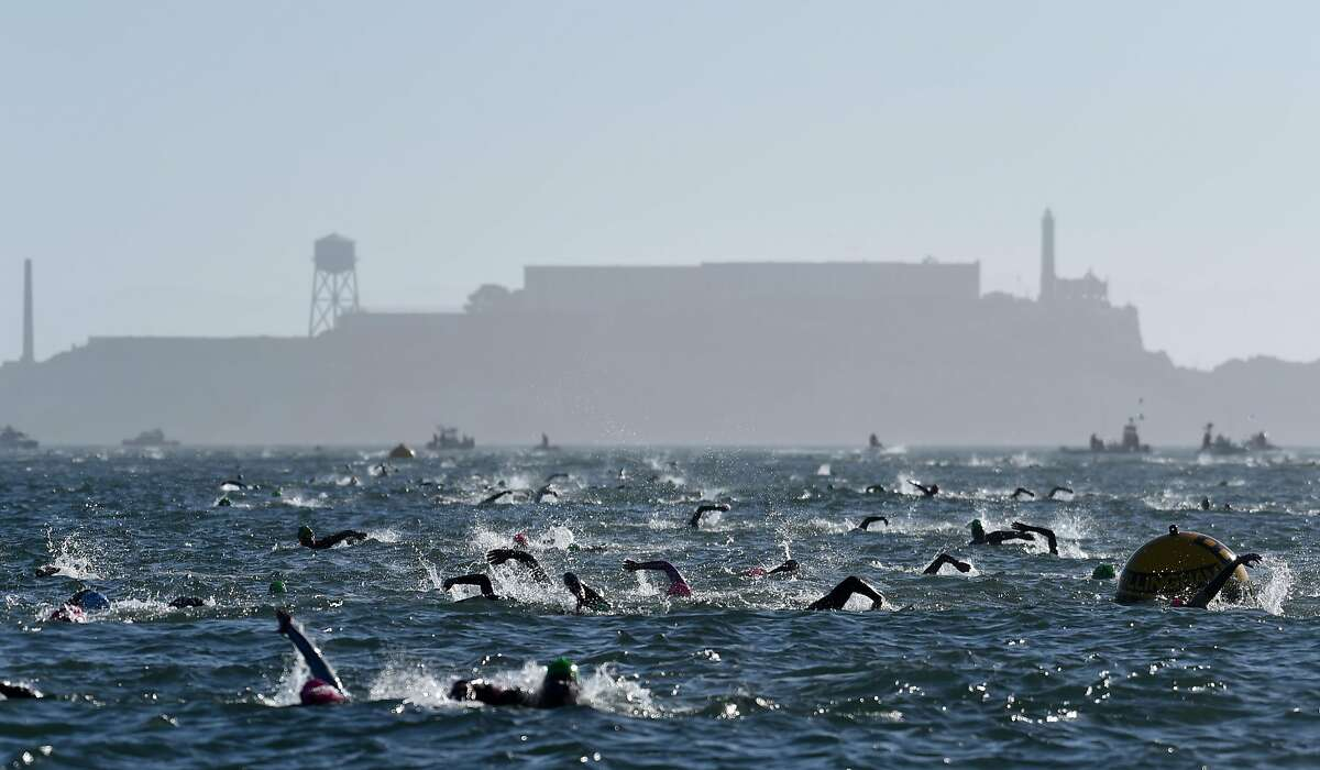 Competitors navigate the choppy waters after swimming from near Alcatraz during the swimming portion of Escape From Alcatraz Triathlon hosted in San Francisco Sunday June 3, 2018.
