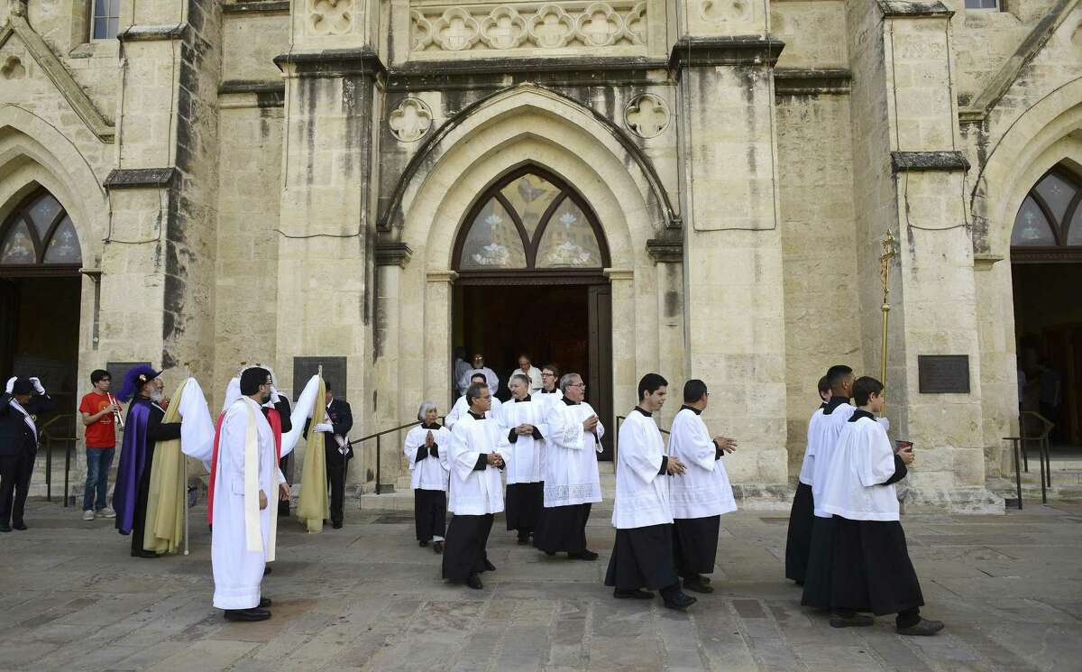 Catholic clergy and faithful exit after Mass at San Fernando Cathedral to participate in a march on Saturday, June 2, 2018.The Archdiocese of San Antonio will temporarily stop distributing sacramental wine due to concerns about the coronavirus.
