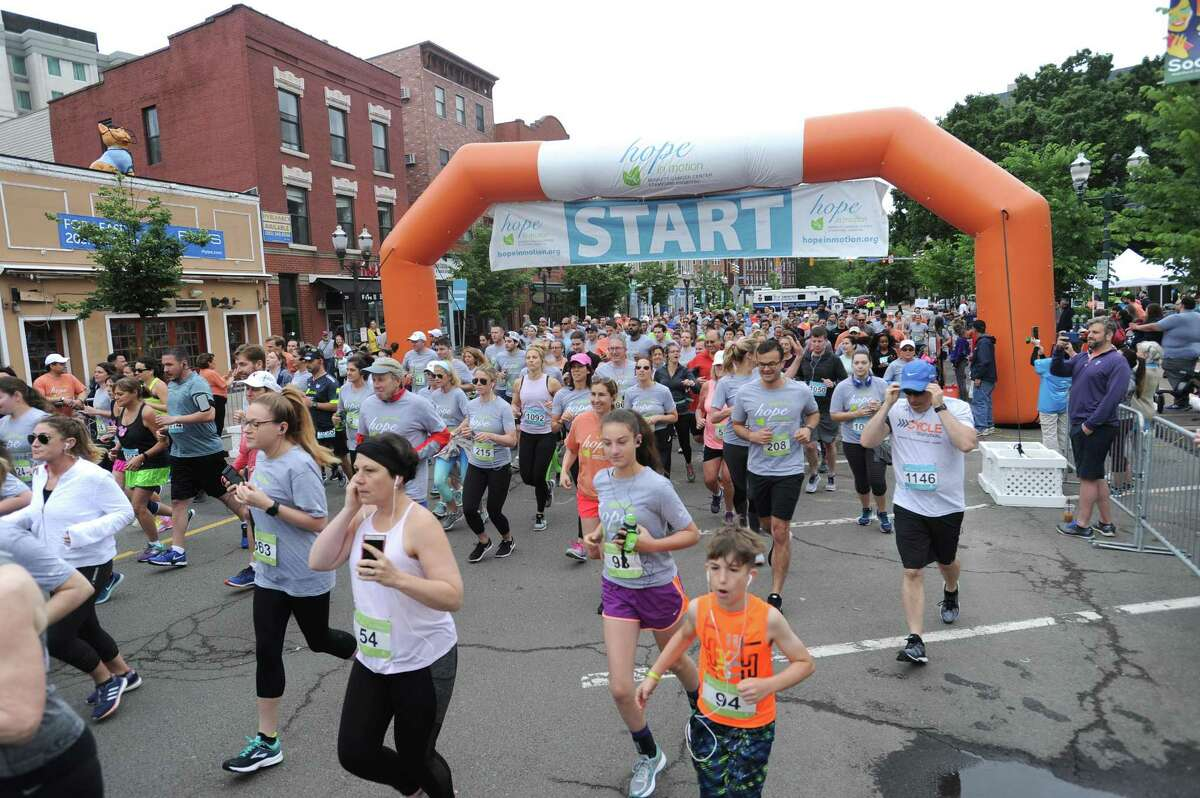 Hundreds of runners begin the 5K/10K on Main St. during the 23rd annual Hope in Motion Walk & Run, hosted by Stamford Health's Bennett Cancer Center, at Columbus Park in downtown Stamford, Conn. on Sunday, June 3, 2018.