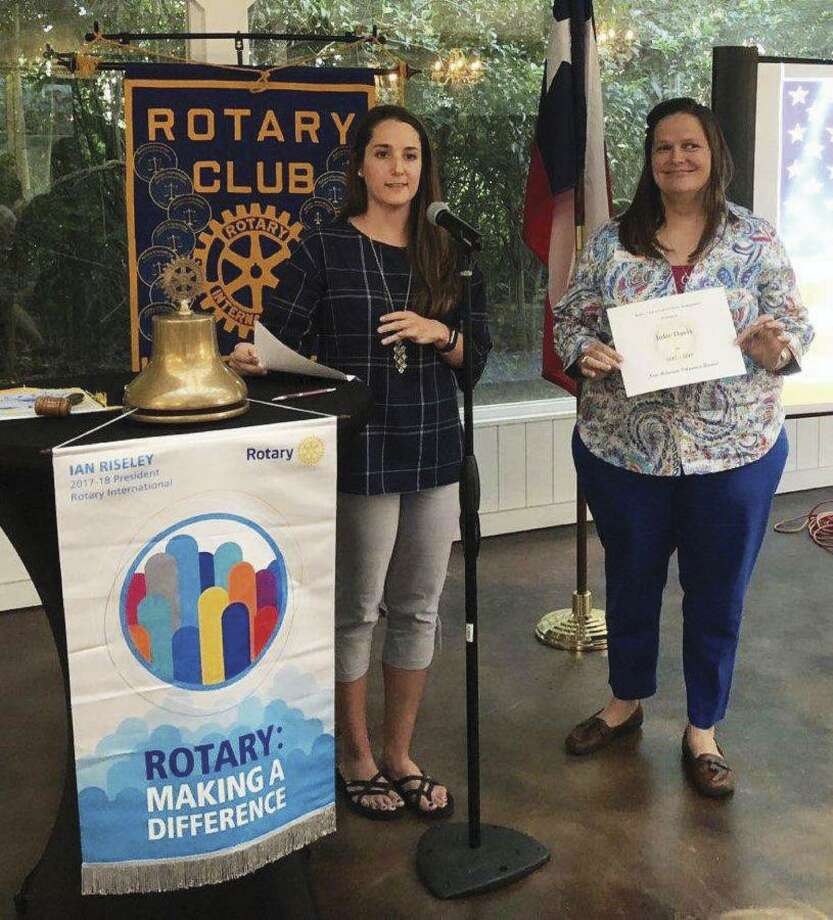 Julie White Davis receives the Non Rotarian Of the Year Award from Rotary Club of Lake Conroe President Victoria Edwards. Julie is the Director of Hope's Bridge Resource Center in Montgomery, an organization that helps fostering and adopting families with donations and resource connections for services.