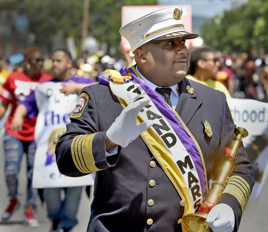 New Haven, Connecticut - June 3, 2018:  New Haven Fire Chief John Alston marches as the Grand Marshall in The Freddie Fixer parade Sunday afternoon on Dixwell Ave. in New Haven. Photo: Peter Hvizdak / Hearst Connecticut Media / New Haven Register