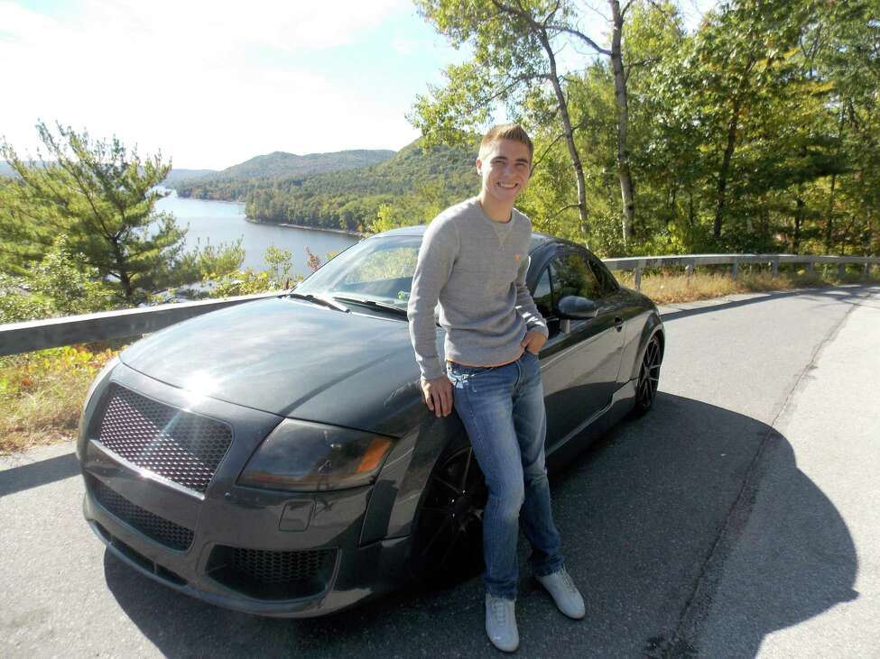 Conor Bradshaw, who was killed in a car crash in October 2017, poses with his car, an Audi TT coupe.