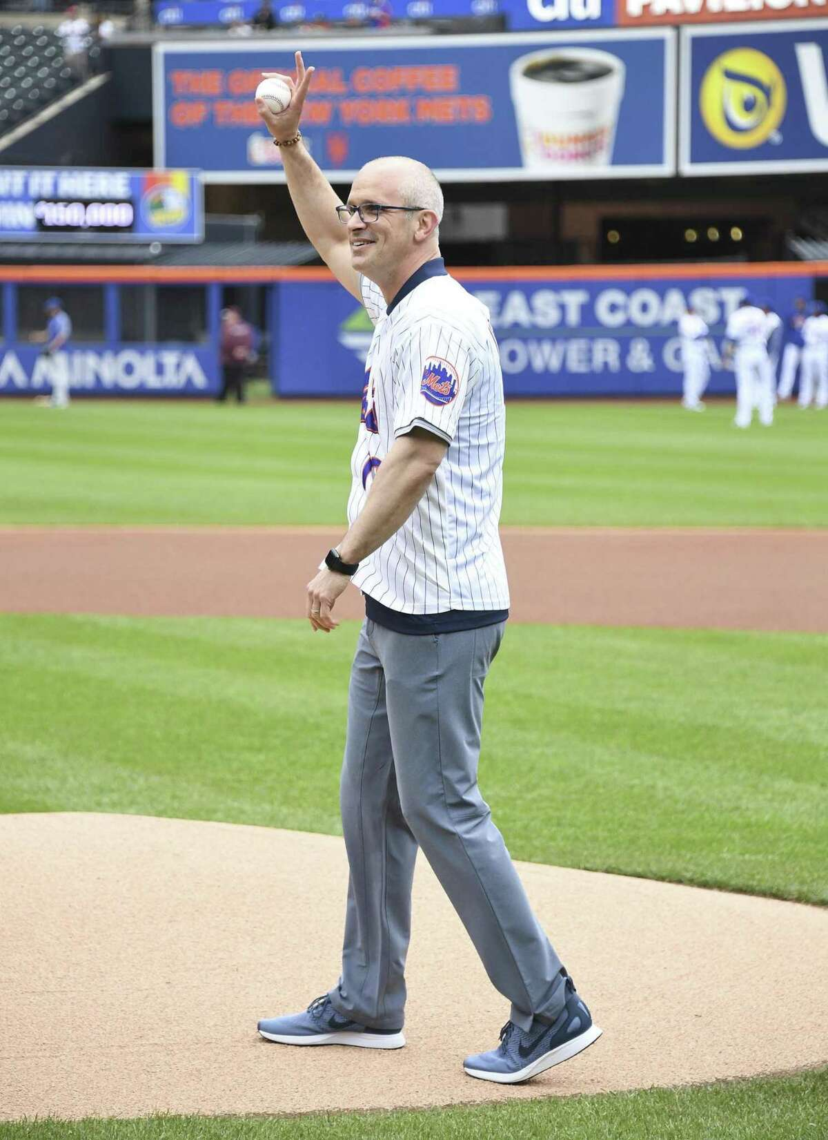 UConn men's basketball coach Dan Hurley gets ready to throw out the ceremonial first pitch before Sunday's game between the Cubs and Mets in New York.
