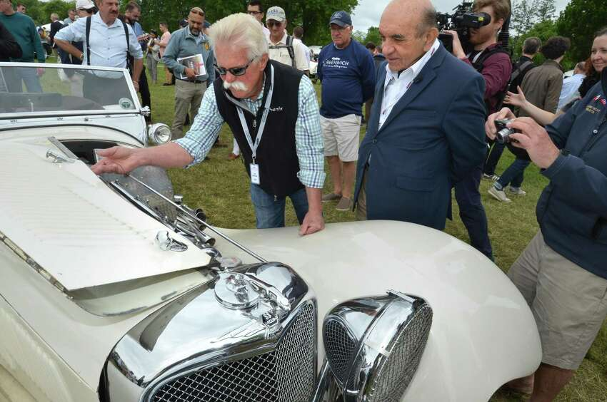 Frederick Simeone, owner of the Simeone Foundation Automotive Museum in Philadelphia Penn. talks about his vintage Jaguar with Chasing Classic Cars Television star Wayne Carini during the Greenwich Concours d'Elegance at Roger Sherman Baldwin Park in Greenwich Conn. on Sunday june 3, 2018