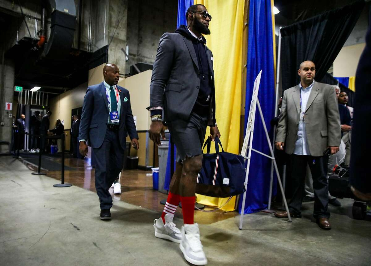 LeBron James (23) walks into Oracle Arena ahead of Game 2 of The NBA Finals between the Golden State Warriors and the Cleveland Cavaliers in Oakland, California, on Sunday, June 3, 2018.