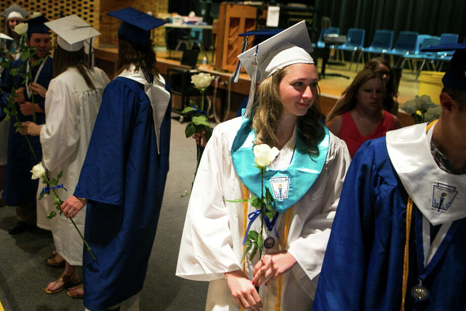 Megan Adams waits in the auditorium before Coleman High School's commencement ceremony on Sunday, June 3, 2018 at Coleman High School. (Mackenzie Brockman/for the Daily News) Photo: Mackenzie Brockman/for The Daily News