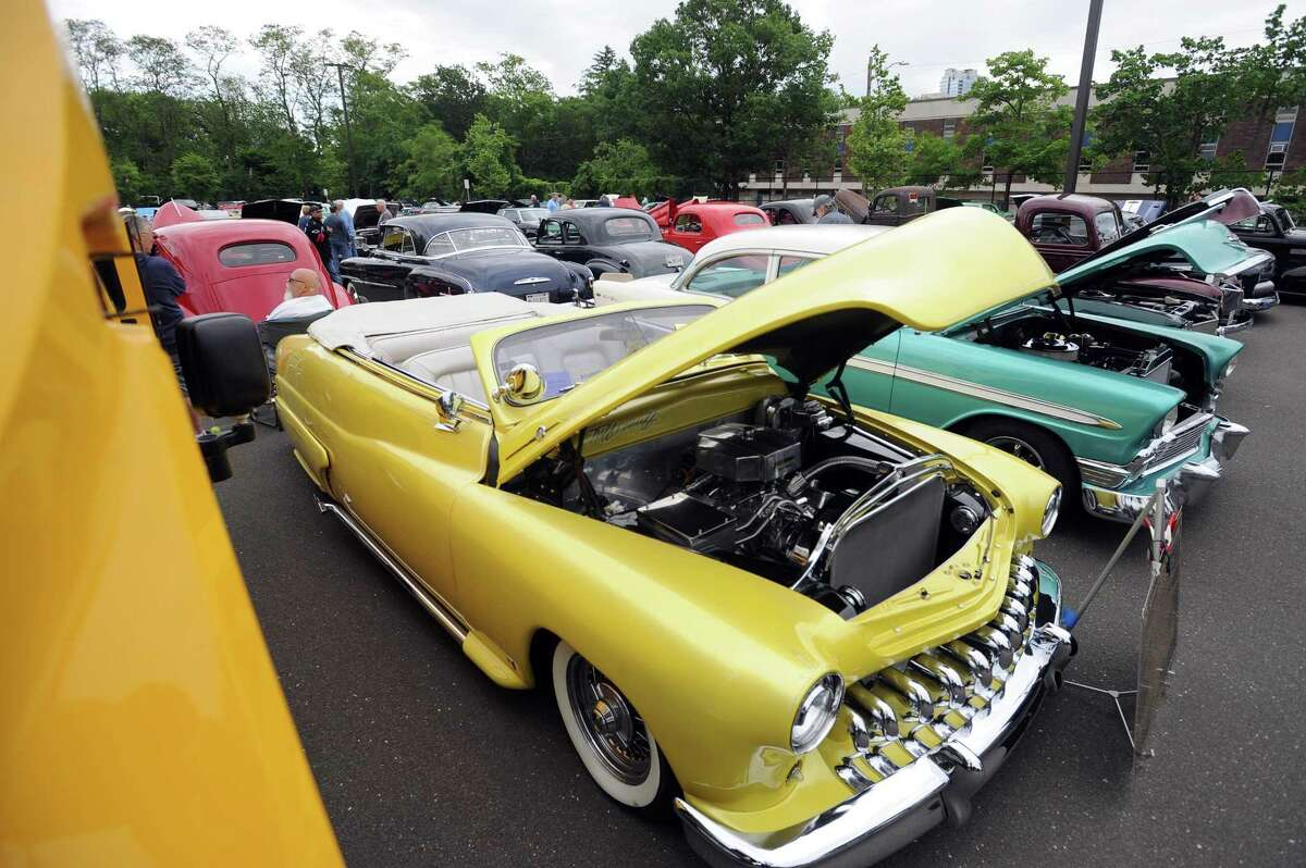 A yellow 1950 Mercury Convertible, owned by Fred Bondi, at the third annual car and motorcycle show, hosted by J.M. Wright Technical School, at Scalzi Park in Stamford on Sunday. All proceeds go toward programs that supporting Wright Tech students.