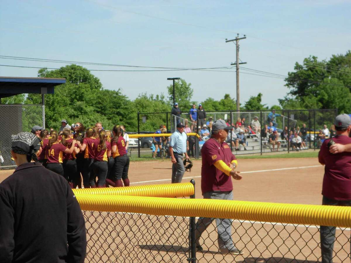 Granby celebrates its 3-2 win over Seymour in the CIAC Class M softball quarterfinals Sunday.