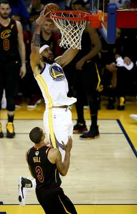 Golden State Warriors center JaVale McGee (1) dunks over Cleveland Cavaliers guard George Hill (3) during the second half of Game 1 of basketball's NBA Finals in Oakland, Calif., Thursday, May 31, 2018. (AP Photo/Ben Margot)