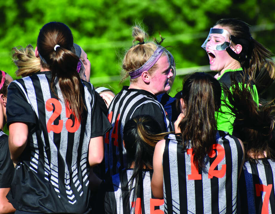 Members of the EHS girls' soccer team get fired up before facing Belleville West in the sectional semifinals in Lebanon.