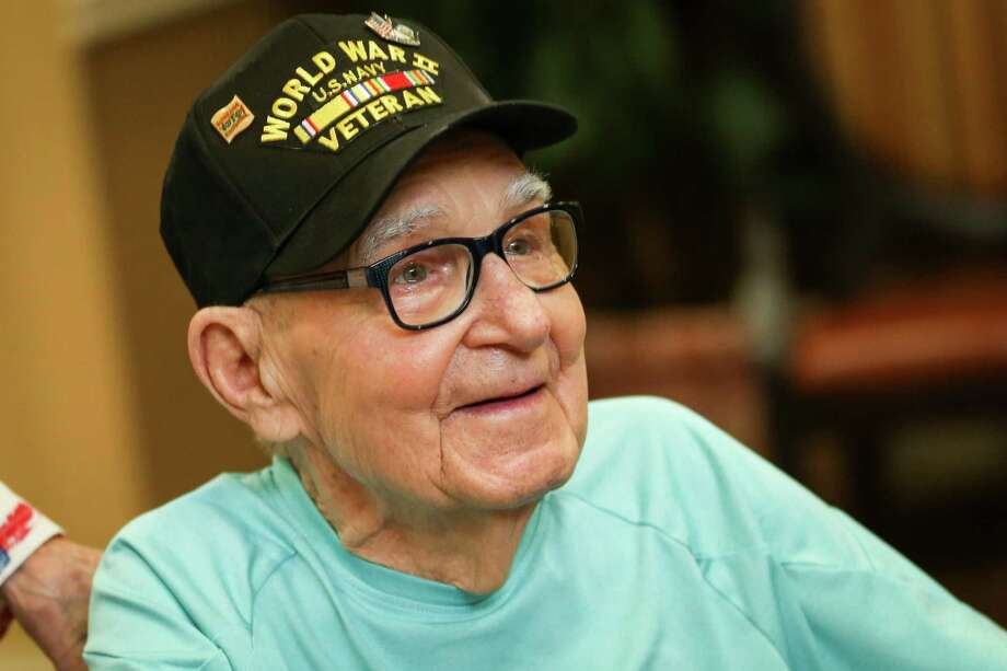 WWII Navy veteran Ramon Handley smiles while speaking with family and guests from VFW Post 4709 during his 90th birthday celebration on Saturday, June 2, 2018, at Brookdale in The Woodlands. Photo: Michael Minasi, Staff Photographer / Houston Chronicle / © 2018 Houston Chronicle