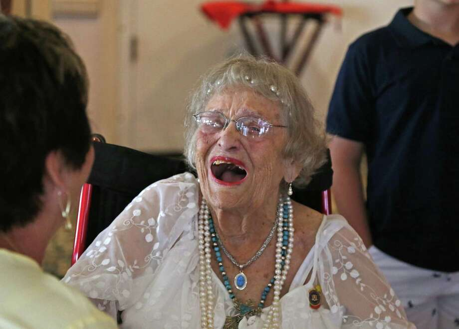 Early Reidland Sheets shares a laugh with friends. Army nurse Earlyne Reidland Sheets marks her 100th birthday at Fort Sam Houston Golf Club, 1050 Harry Wurzbach Rd, San Antonio, TX 78209 on Sunday, June 3,2018. Photo: Ronald Cortes, For The San Antonio Express News / 2018 Ronald Cortes