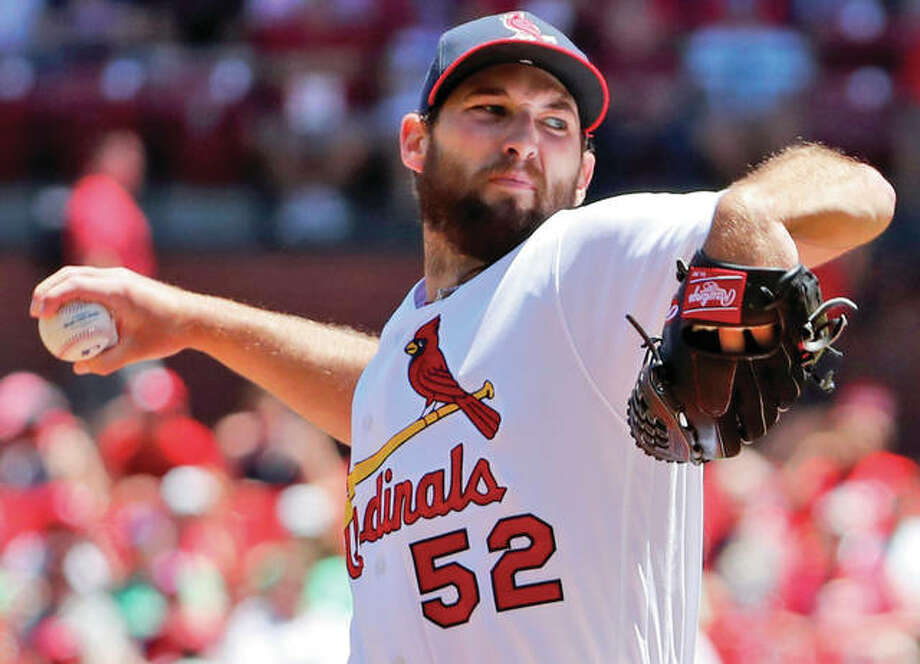 Cardinals pitcher Michael Wacha works to the plate against Pirates on Sunday at Busch Stadium. Photo:     Associated Press