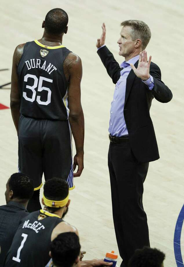 Golden State Warriors  head coach Steve Kerr talks to Kevin Durant in the  first quarter 767facc8d
