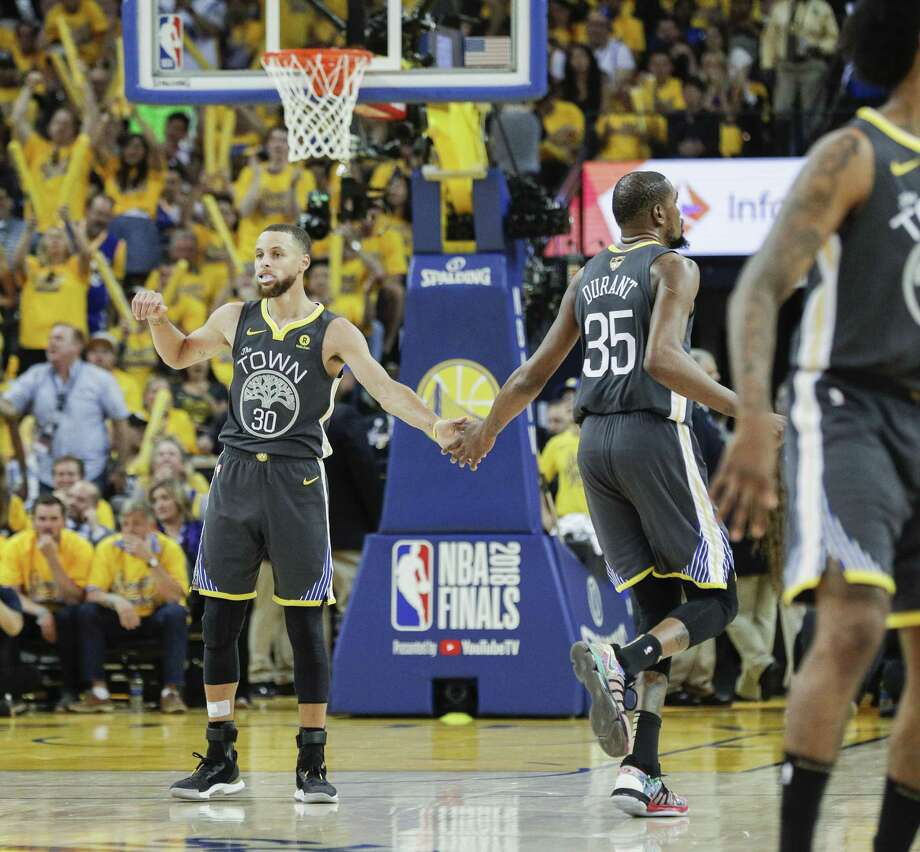0e830679694 Golden State Warriors  Stephen Curry and Kevin Durant touch hands in the  second quarter during