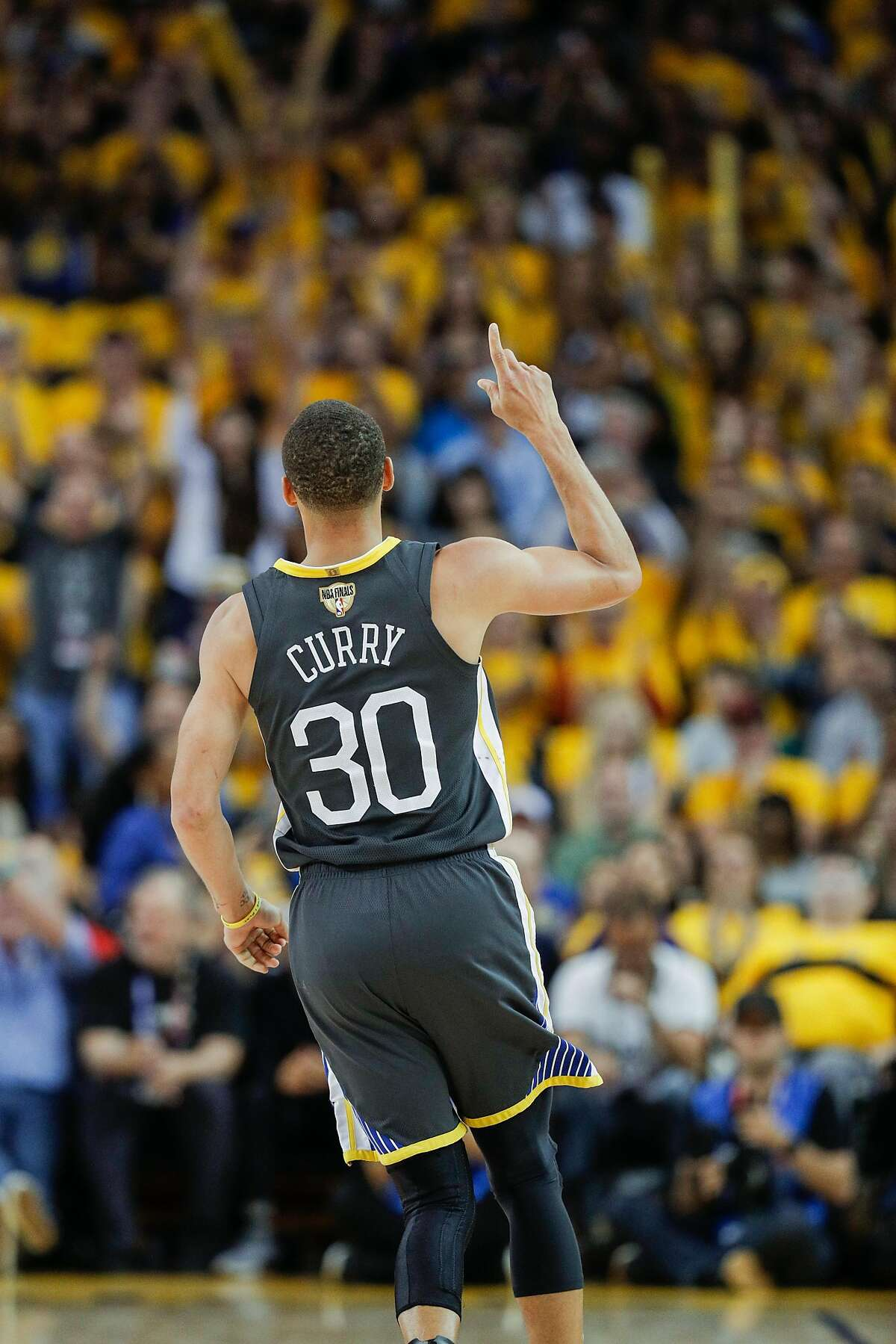 Golden State Warriors' Stephen Curry reacts after scoring in the fourth quarter during game 2 of The NBA Finals between the Golden State Warriors and the Cleveland Cavaliers at Oracle Arena on Sunday, June 3, 2018 in Oakland, Calif.