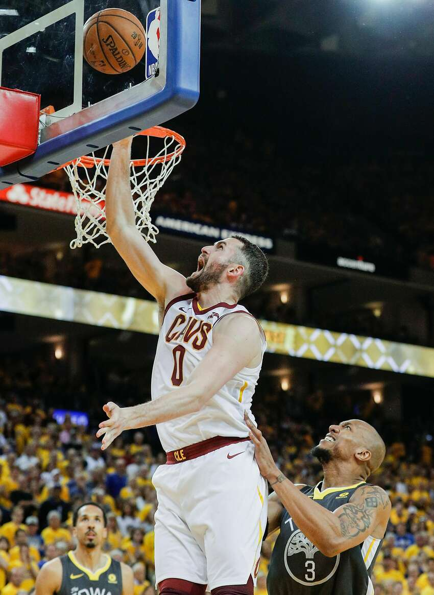 Cleveland Cavaliers' Kevin Love drives past Golden State Warriors' David West in the fourth quarter during game 2 of The NBA Finals between the Golden State Warriors and the Cleveland Cavaliers at Oracle Arena on Sunday, June 3, 2018 in Oakland, Calif.