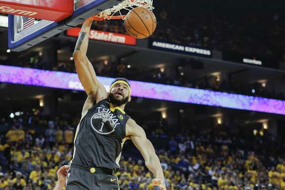 Golden State Warriors' JaVale McGee dunks in the second quarter during game 2 of The NBA Finals between the Golden State Warriors and the Cleveland Cavaliers at Oracle Arena on Sunday, June 3, 2018 in Oakland, Calif.