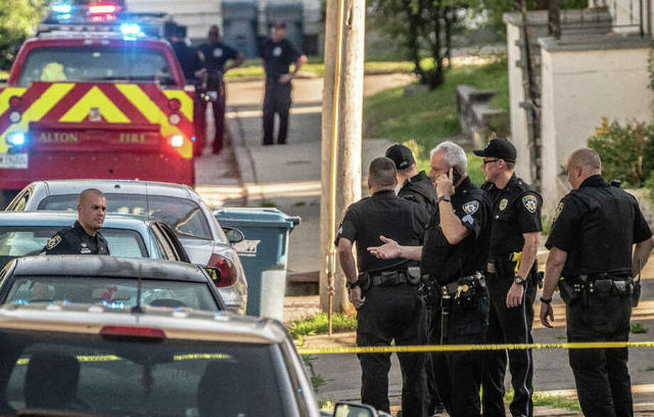 Alton police block off a portion of the 700 and 800 blocks of Ridge Street Sunday evening while investigating the stabbing of a male and female. The victims were found at separate addresses. Both appeared critically wounded. Photo:       Nathan Woodside | For The Telegraph
