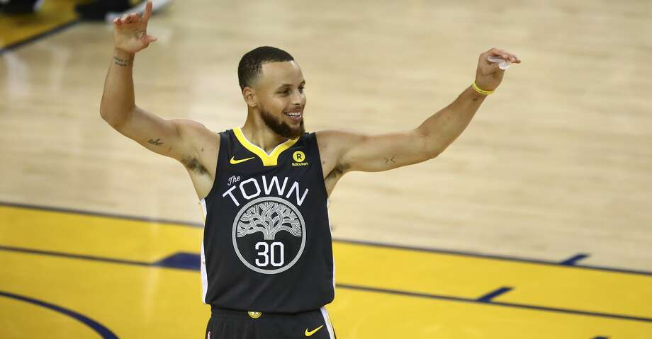 f1fc9d3858fb Golden State Warriors guard Stephen Curry (30) celebrates during the second  half of Game