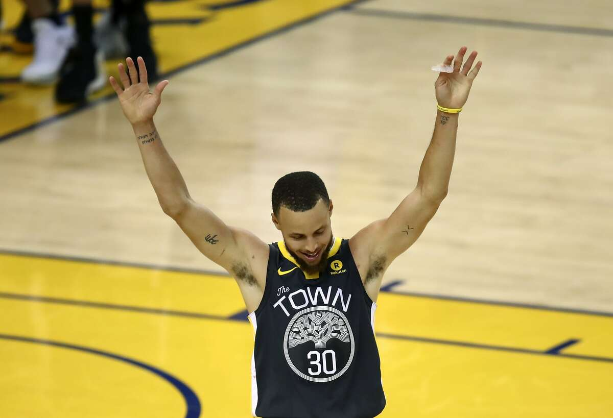 Golden State Warriors guard Stephen Curry (30) celebrates during the second half of Game 2 of basketball's NBA Finals between the Golden State Warriors and the Cleveland Cavaliers in Oakland, Calif., Sunday, June 3, 2018. (AP Photo/Ben Margot)