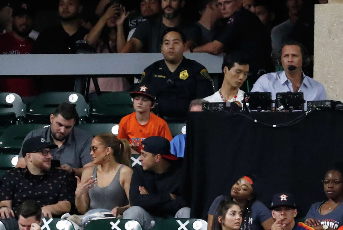 Jennifer Lopez walks past Alex Rodriguez who is at the ESPN booth during the ninth inning of an MLB baseball game at Minute Maid Park, Sunday June 3, 2018, in Houston. ( Karen Warren / Houston Chronicle )