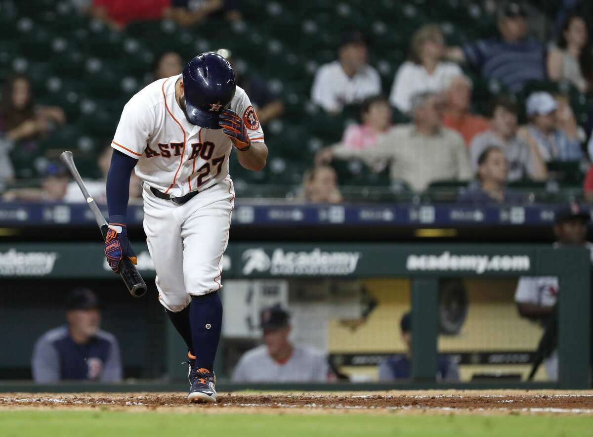 Houston Astros Jose Altuve (27) reacts after flying out with two runners on base during the ninth inning of an MLB baseball game at Minute Maid Park, Sunday June 3, 2018, in Houston. ( Karen Warren / Houston Chronicle )