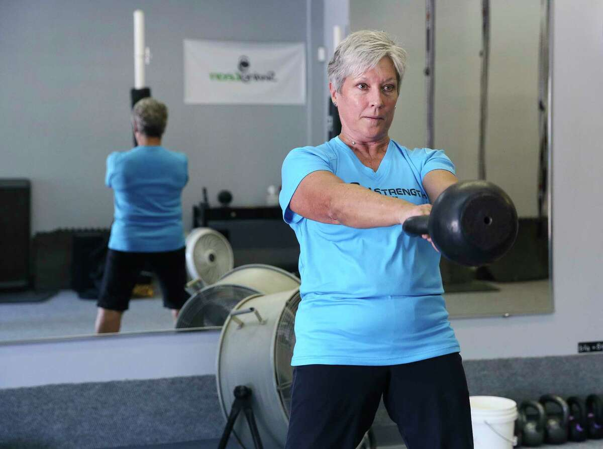Iron Strength Kettlebell Gym Owner and Instructor Angie Jameson demonstrates how to swing a kettlebell for exercise on Thursday, May 31, 2018, in Sugar Land. The average Houston apartment is about 800 square feet. So how are you supposed to work out in such a small space? Fitness experts and a home organizer offer some tips to help you hack your apartment.