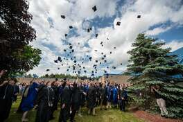 Scenes from Gladwin High School's commencement ceremony on Sunday, June 3, 2018 in the school's gymnasium. (Steven Simpkins/for the Daily News)