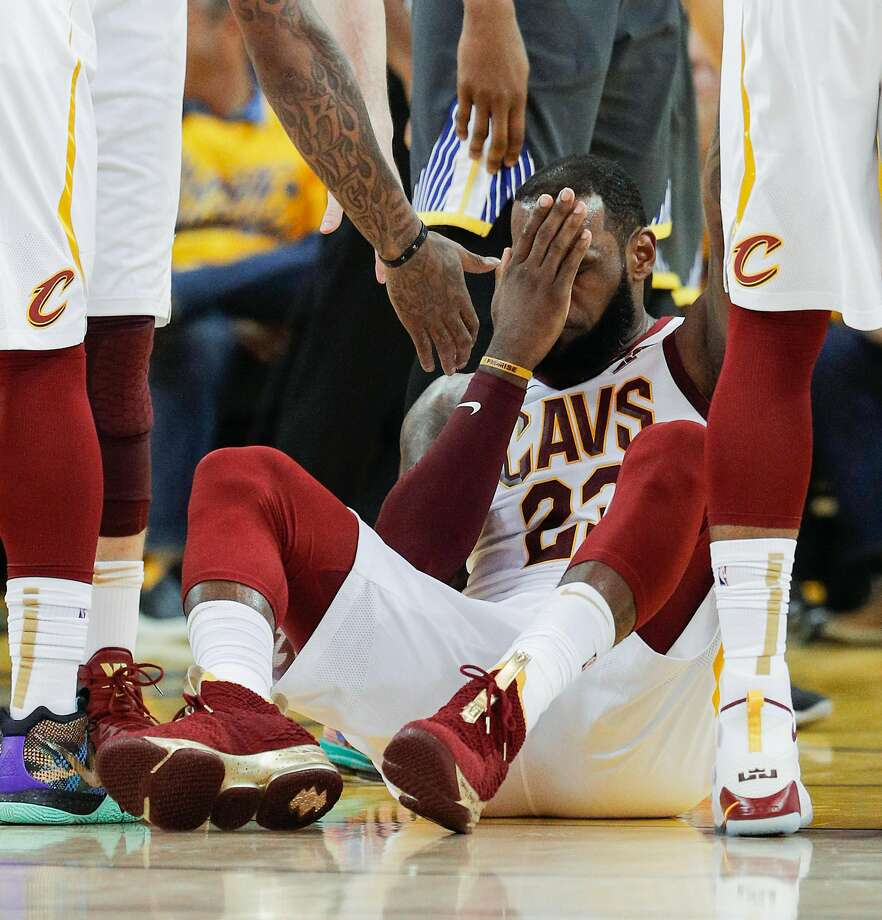 009b2125ed6 Cleveland Cavaliers  LeBron James holds his face after colliding with  Golden State Warriors  Draymond