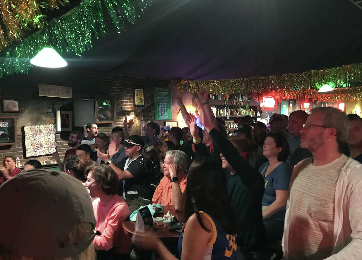 Fans watch Game 2 of the NBA Finals between the Golden State Warriors and the Cleveland Cavaliers at San Francisco's Clusterfest on June 3, 2018.