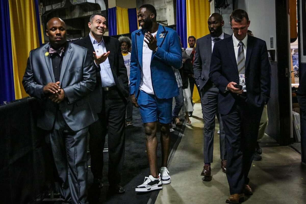 Draymond Green (23) (center) walks through Oracle Arena after Game 2 of The NBA Finals between the Golden State Warriors and the Cleveland Cavaliers in Oakland, California, on Sunday, June 3, 2018.