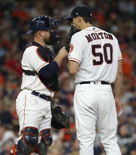 Houston Astros starting pitcher Charlie Morton (50) chats with catcher Max Stassi (12) during the second inning of an MLB baseball game at Minute Maid Park, Sunday June 3, 2018, in Houston. ( Karen Warren  / Houston Chronicle ) Photo: Karen Warren/Houston Chronicle