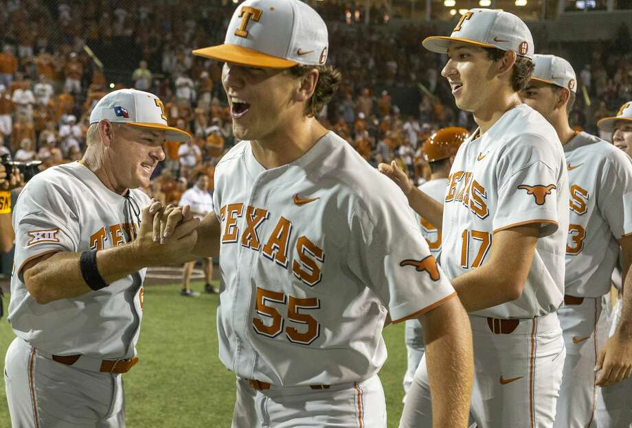Texas head coach David Pierce, center, celebrates a 3-2 win over Indiana with Sam Bertelson (55) and Nico O'Donnell (17) during an NCAA regional game at UFCU Disch-Falk Field in Austin, Texas, Sunday, June 3, 2018. (Stephen Spillman) Photo: Stephen Spillman