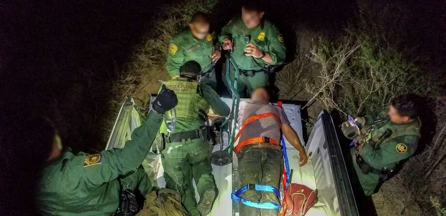 Border Patrol renders aid to an undocumented immigrant on Wednesday after got lost in a ranch near Laredo. Photo: Border Patrol /Courtesy Photo