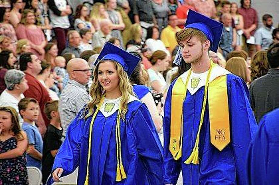Class of 2018 members enter the North Greene High School graduation ceremony Friday. Photo:       David Blanchette | Journal-Courier
