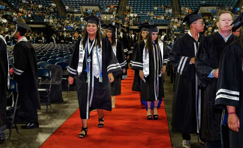 Graduates from the United South High School class of 2018 take their places during the school's commencement ceremony on Saturday, Jun 1, 2018 at the Laredo Energy Arena. Photo: Danny Zaragoza, Laredo Morning Times / Laredo Morning Times