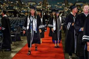 Graduates from the United South High School class of 2018 take their places during the school's commencement ceremony on Saturday, Jun 1, 2018 at the Laredo Energy Arena.