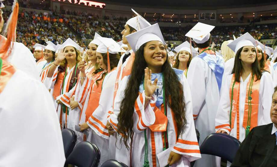 United High School graduates look to their families in the stands on Friday, Jun 2, 2018 at the Laredo Energy Arena. Photo: Danny Zaragoza, Laredo Morning Times