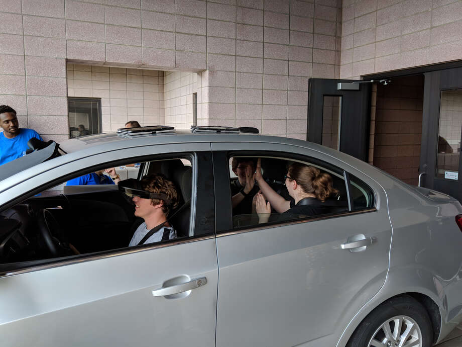 Beaverton High School students take part in a Distracted Driving Simulator that creates a real-world teenage driving experiences. Most of the students said it was not easy. (Tereasa Nims/For the Daily News) Photo: Tereasa Nims, For The Daily News