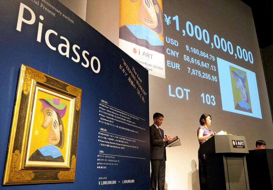 "STANDALONE PHOTO: ""Weeping Woman,"" an oil painting by Pablo Picasso (1881-1973), has sold for 1 billion yen (9.13 million U.S.) in Tokyo, setting a national record for a winning bid at a domestic company's art auction. According to iArt Co., which organized the Saturday auction, the previous record was 360 million yen for an oil painting titled ""Reiko in a Woolen Shawl"" by Ryusei Kishida, at an art auction in Tokyo organized by Shinwa Auction Co. in 2000. The purchaser of ""Weeping Woman"" has not been made public. Photo: Japan News-Yomiuri Photo / Japan News-Yomiuri"