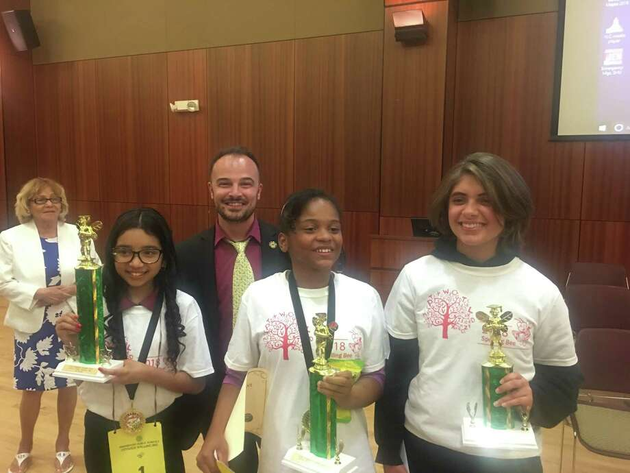 Winners of the Bridgeport district 2018 spelling bee. First place: Kacey Cartagena grade 5 Classical Studies Magnet Academy, Second place: Skyela Kemp grade 6 Geraldine Johnson, Third Place: Kathryn Velazquez grade 8 High Horizons Magnet  Back row: Shaun Mitchell, Spelling Bee Pronouncer and English teacher at Central High School. Photo: Contributed /