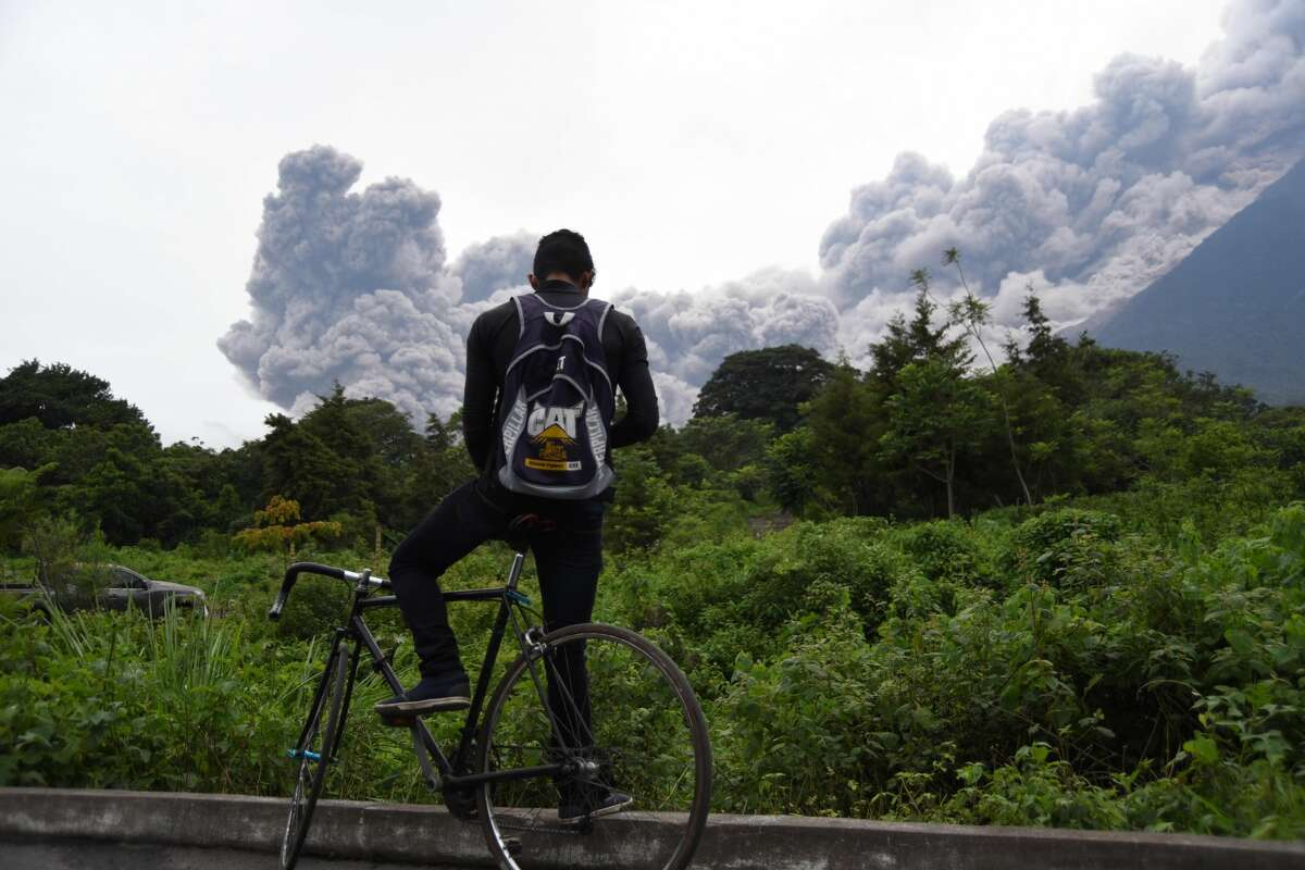 A man looks at the Fuego Volcano in eruption, from Alotenango municipality, Sacatepequez department, about 65 km southwest of Guatemala City, on June 3, 2018.