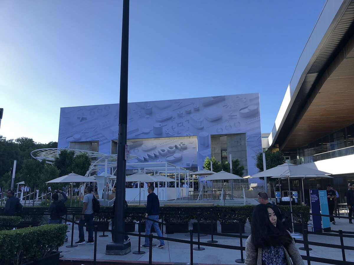 Attendees arrive for Apple's annual developer conference, WWDC, at San Jose McEnery Convention Center.