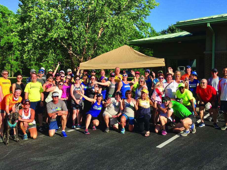 Members of the Metro Milers celebrate Edwardsville being named a Runner Friendly Community.