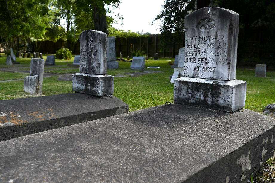 A grave for C.E. McLain at the Spell Cemetery on Caswell Road in Beaumont. The community burial ground was the final resting place for residents of the former Rosedale community. Photo: Ryan Pelham / Ryan Pelham/The Enterprise / ©2018 The Beaumont Enterprise/Ryan Pelham