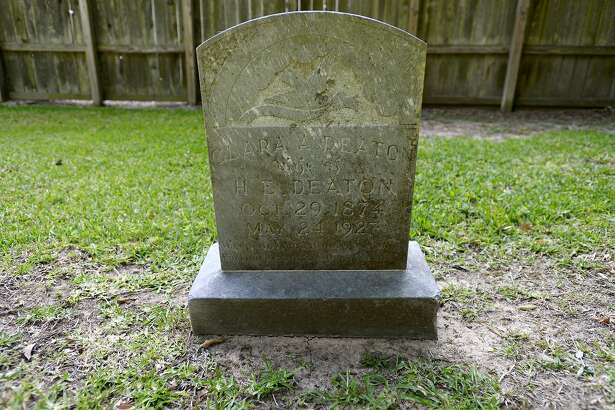 A tombstone for Clara A. Deaton, wife of H.E. Deaton, at the Spell Cemetery on Caswell Road in Beaumont. The community burial ground was the final resting place for residents of the former Rosedale community. Photo taken Thursday 5/17/18 Ryan Pelham/The Enterprise