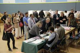 FILE- In this Nov. 8, 2016 file photo, people vote at a polling place set up at the Kenter Canyon Elementary School in Los Angeles. California's primary election on Tuesday, June 5, 2018, includes races for governor, U.S. Senate and other statewide offices, all 53 U.S. districts and most seats in the Legislature. (AP Photo/Nick Ut, File)