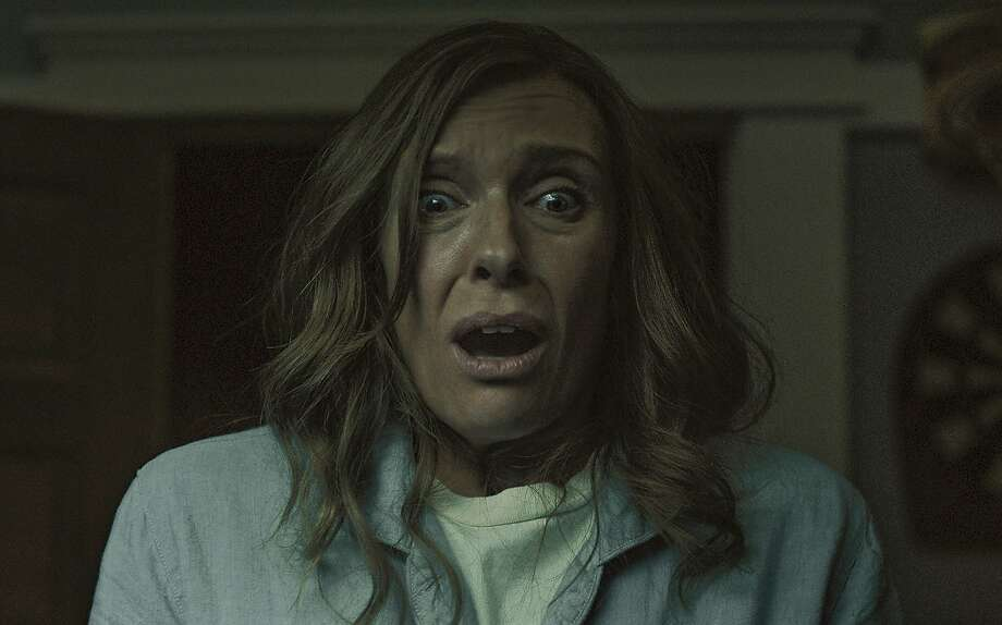 "Annie (Toni Collette) becomes unglued as apparitions tear her family apart in the supernatural thriller ""Hereditary."" Photo: A24"